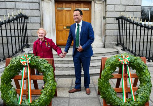 Christina Long, whose father Henry Cassidy fought at the Royal College of Surgeons and was a member of the Irish Citizen Army is pictured with Leo Varadkar at the RCSI Photo: Maxwells Dublin