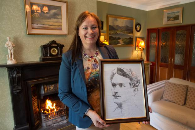 Legacy: Anne Kirwan, who lives in Ashe House in Lusk, holds a drawing of former resident Thomas Ashe. Photo: Fergal Phillips