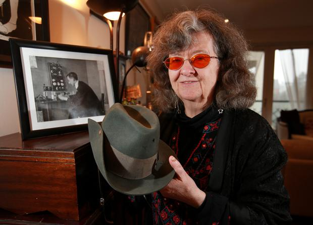 Tragedy: Honor O Brolchain, grand-niece of Joseph Plunkett, pictured with the hat (with a bullet hole) he wore in the GPO during the Rising. Photo: Frank McGrath