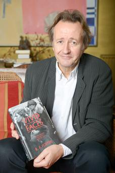 Professor Roy Foster photographed with his book Vivid Faces in Kentish Town, London. Photographs: Tony Kershaw