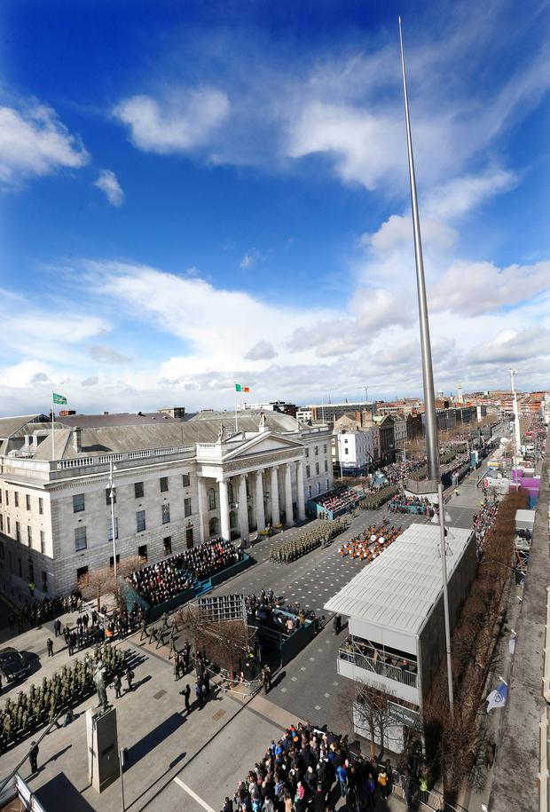 Members of the Defence Forces march past the GPO on Dublin's O'Connell Street during the 1916 commemoration parade on Easter Sunday. Gerry Mooney