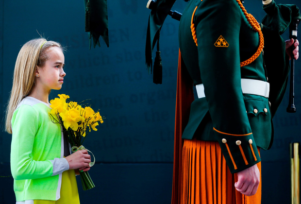 Maria Mellon holds daffodils during the Easter Sunday Commemoration Ceremony at the GPO on Easter Sunday, 2016. Photo: Maxwells
