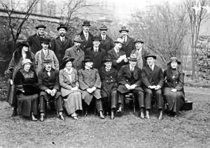 Senior members of Sinn F�in, possibly at the party's October 1919 Ard Fheis. Due to the British suppression of Sinn F�in this was the last Ard Fheis held until 1921. From left to right in the front row, seated: Hanna Sheehy-Skeffington, Harry Boland, Unknown, Unknown, Eamon De Valera, Michael Collins, Arthur Griffith, Unknown. (Part of the Independent Newspapers Ireland/NLI Collection)