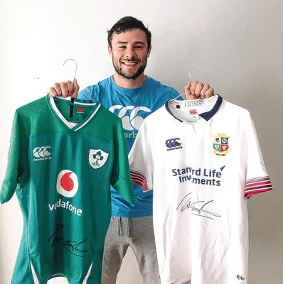 Shirt order: Robbie Henshaw shows off his signed Ireland shirt and Lions training top, which will be among the raffle prizes