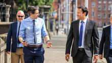 Taoiseach Leo Varadkar and Health Minister Simon Harris on their way in to Government buildings this morning.  Picture; Gerry Mooney