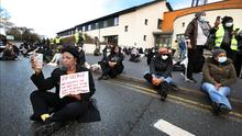 A sit-down protest outside Blanchardstown Garda Station following last week's shooting dead of George Nkencho. Photo: Steve Humphreys