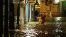 A woman walks through flood water in Cork city.