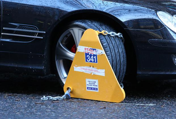 Maximum charges for releasing a clamp or relocating a vehicle will finally be signed off by the Cabinet. Stock Image