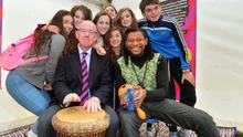 Minister for Forgein Affairs and Trade, Charlie Flanagan, with percussion teacher Eche Gabriel Akujobi and people who took part in the 'Beat the Drum' class at the Irish Aid tent at the National Ploughing Championship in Co. Laois
