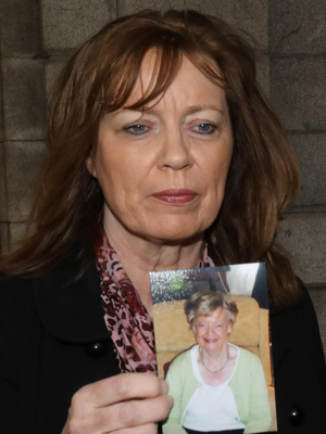 Geraldine Eaton, from Templeogue, Dublin, holds a photograph of her mother Letitia Lawlor, who died after a fall in hospital, outside the Four Courts yesterday Photo: Collins Courts