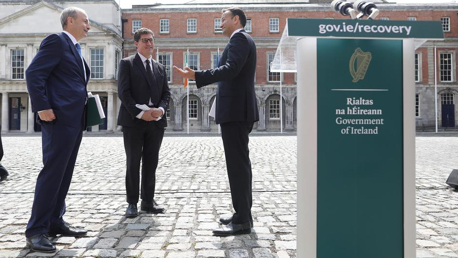 Taoiseach Micheál Martin, Tánaiste Leo Varadkar, and Minister for the Environment, Climate and Communications Eamon Ryan launching the Economic Recovery Plan in the courtyard of Dublin Castle yesterday. Photo: Julien Behal