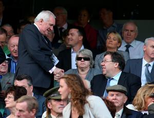 Former Taoisigh, Bertie Ahern and Brian Cowen shake hands before the All-Ireland Football Final in Croke Park yesterday.