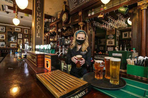 Owner Sinead Conlon prepares the first drinks for customers Slatterys pub on Capel street. Picture; Gerry Mooney