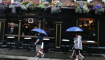 Outdoor dinning on Exchequer Street in Dublin during heavy rain. Photo: Stephen Collins/Collins Photos