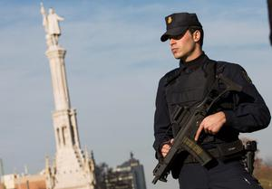 An armed Spanish police officer stands guard during a security operation at Colon square in central Madrid yesterday. Photo: Reuters