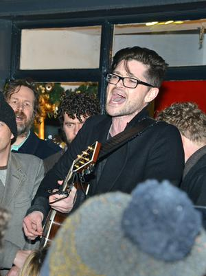 Danny O'Donoghue from The Script performs during the annual Christmas Busk in aid of the Simon Community and Peter McVerry Trust, on Grafton Street in Dublin, on Christmas Eve.