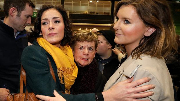 Fine Gael's Kate O'Connell is comforted by her sister Theresa Newman at the RDS after losing her seat