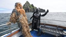In character: 'Star Wars' fans dressed as Chewbacca and Darth Vader visit Skellig Michael. Photo: Justin Kernoghan