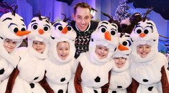 Toy story: 'Late Late' host Ryan Tubridy with some of the young performers, all dressed as Olaf from 'Frozen', who will be part of tonight's show. Photo: Steve Humphreys
