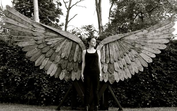 Heavenly creature: Artist Rachel Kiernan, wearing a giant set of wings she made from recycled wooden pallets, will perform at this year's Electric Picnic