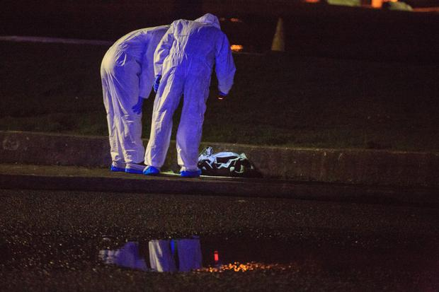 Investigation: Forensic experts examine a bag believed to contain body parts in Coolock last night. Photo: Mark Condren