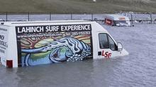 Two vans trapped in water at Lahinch car park. Press 22
