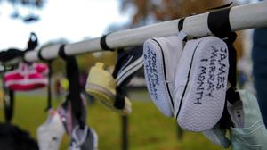 Betrayed: Protesters hang babys' shoes outside Áras an Uachtaráin to highlight their opposition to the sealing of records into the Tuam mother and baby home scandal