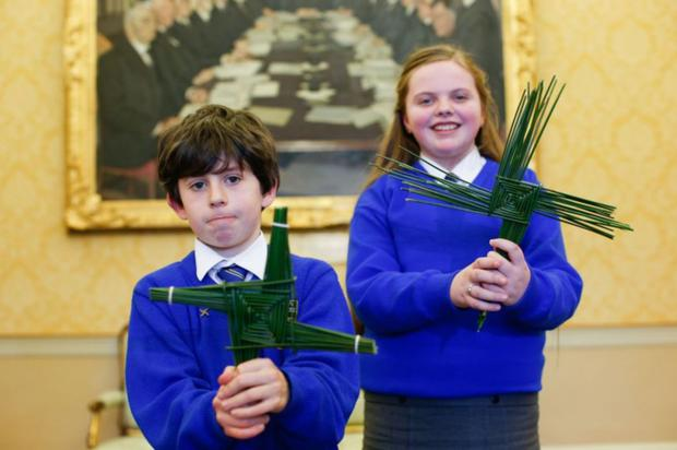Tradition: Oisín Lee and Sofia Hannon from St Brigid's Primary School, Kildare town, with St Brigid's crosses which they made for President Michael D Higgins at Áras an Uachtaráin. Photo by Kenneth O'Halloran (2020)