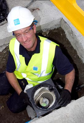 Delays: Dave Fenton from GMC Sierra installs the first water meter in Maynooth, Co Kildare, in August 2013. PHOTO: COLM MAHADY
