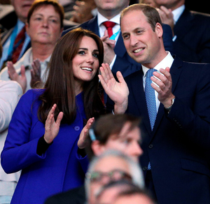 The Duke and Duchess of Cambridge applaud during the opening ceremony Photo: PA