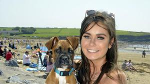 Charlotte Murnane from Macroom enjoying the sunshine at the beach with her dog Willow. Photo: Denis Boyle