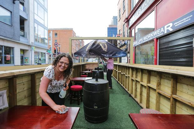 Getting the outdoor tables ready for a big day Picture: Gerry Mooney