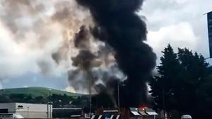 A large fire that has broken out in Strabane. Photo: Bernie Mullen/PA Wire