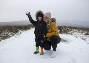 Lucas Evans (3) and his mother Gill, from Lucan, play in the snow in Glencree in Glencree, Co Wicklow.
