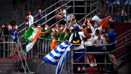 Members of Team Ireland celebrate as Jason Smyth of Ireland receives his gold medal