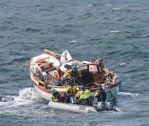 Rescuers fromthe Naval Service arrive at the stricken yacht