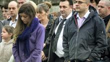 Chermaine Carroll's mother Michelle and father Miley with mourners at her funeral