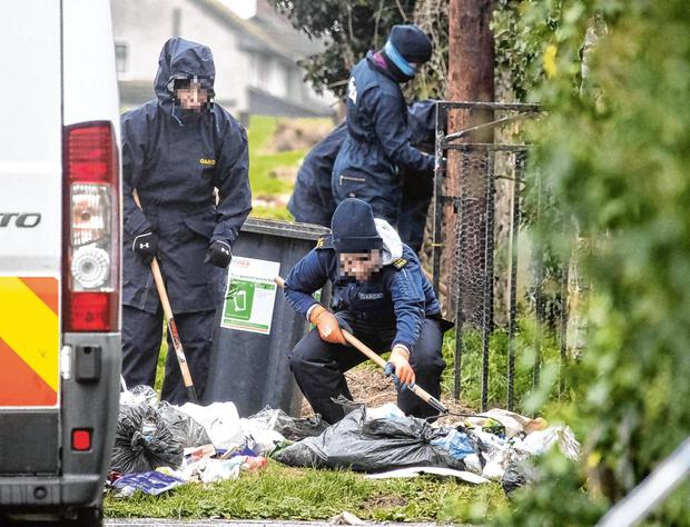 Gardaí search an area around a house in                       Rathmullen Park, Drogheda, in relation to the                       death of Keane Mulready-Woods. Photo: Colin                       Keegan