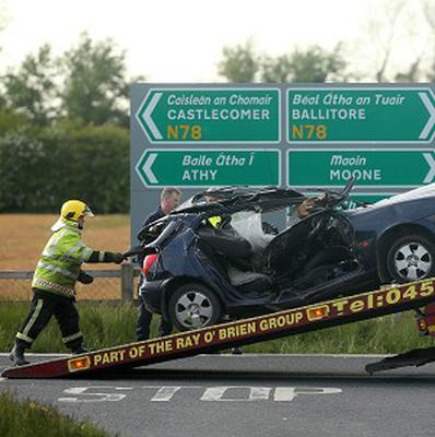 A car is loaded onto a lorry on the N78 close to Athy, Co Kildare after two people died in a road crash
