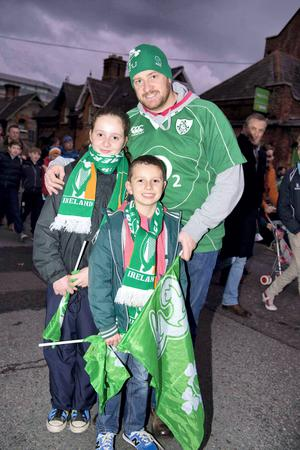 Fans Colleen (11), Donnacha (8), and David O'Rahilly from Bruff after Ireland defeated Georgia. Picture: El Keegan.