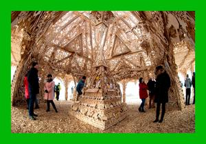 Visitors at the Temple by renowned Burning Man artist David Best in Derry