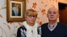 Breege and Stephen Quinn stand in front of a photograph of their murdered son Paul. Photo: Colm Lenaghan/Pacemaker Press
