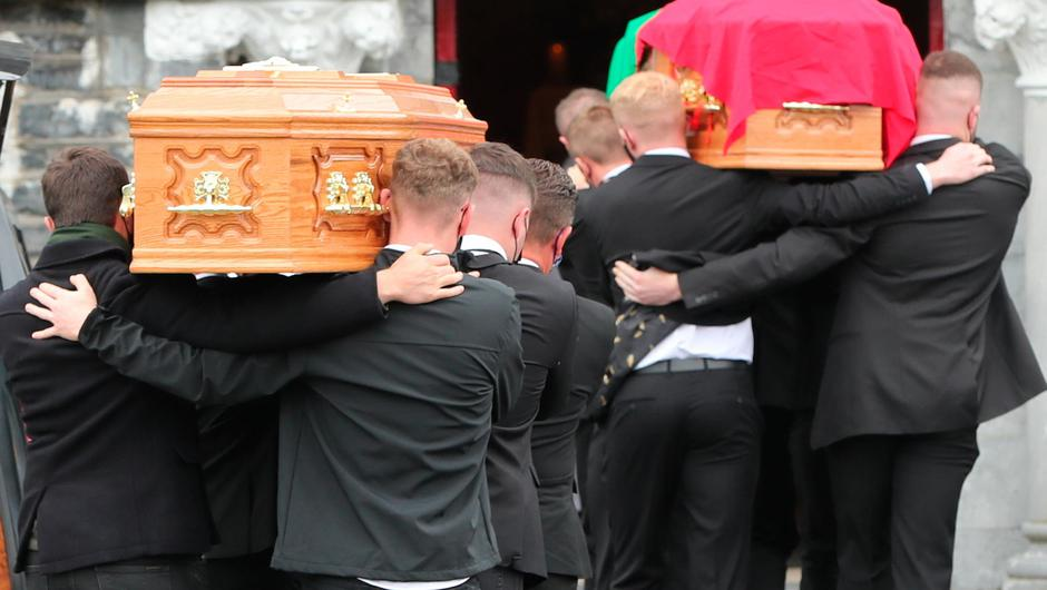 The coffins of Eileen and Jamie O'Sullivan are carried into St Michael's Church in Lixnaw in North County Kerry. Niall Carson/PA Wire