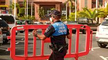 Top: A policeman blocks access to the hotel in Tenerife. Photo: AP