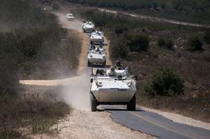 Members of the UN Disengagement Observer Force (UNDOF) ride armoured personnel carriers  in the Israeli-occupied Golan Heights. Photo: Reuters