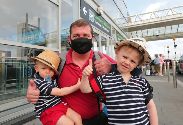 Return of non essential international travel Dublin Airport. Darren Jarvis with his sons Bjorn (1) and Reuben (3) who were departing for Verona. Picture; Gerry Mooney
