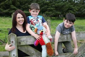 Concerns: Teacher Catriona Doherty and her sons Tiernan (7) and Conall (5). Photo By Lorcan Doherty