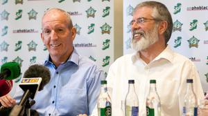 Bobby Storey (left) and former Sinn Fein president Gerry Adams