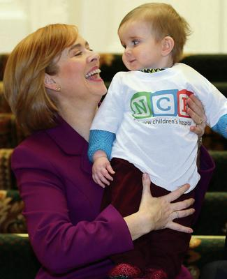 Chief executive Eilish Hardiman pictured with nine-month-old Patrick Hempenstall at the briefing on the National Children's Hospital in Dublin yesterday. Picture: Frank McGrath