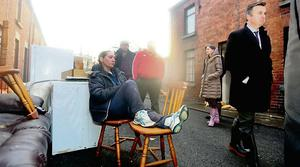 Junior minister Brian Hayes at Mary's Park in Limerick as Geraldine Fitzgerald sits on the last of her furniture. Photo: Brian Arthur/ Press 22